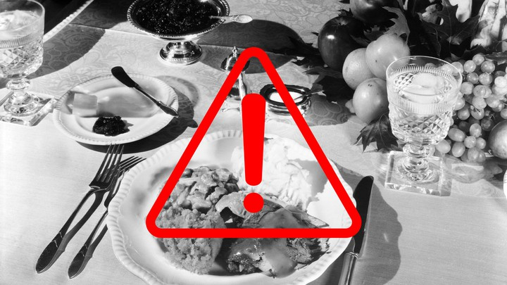 A Thanksgiving meal with a warning sign superimposed over it