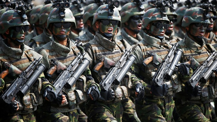 North Korean special forces soldiers march and shout slogans during a military parade marking the 105th birth anniversary of country's founding father, Kim Il Sung in Pyongyang, North Korea, on April 15, 2017.