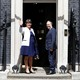 The leader of the Democratic Unionist Party (DUP), Arlene Foster, and the Deputy Leader Nigel Dodds, stand on the steps of 10 Downing Street before talks with Britain's Prime Minister Theresa May on June 13, 2017.