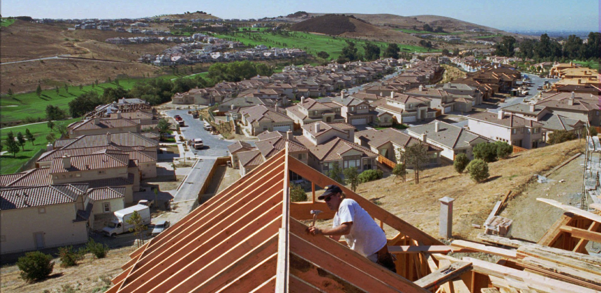 A worker builds new homes in San Jose.