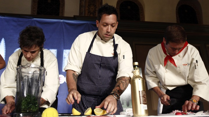 'Top Chef: Las Vegas' contestants Ashley Merriman, Mike Isabella, and Mattin Noblia cook during the presentation for 'Top Chef: Las Vegas' at the NBC Universal Television Critics Association summer press tour in Pasadena, California, on August 5, 2009
