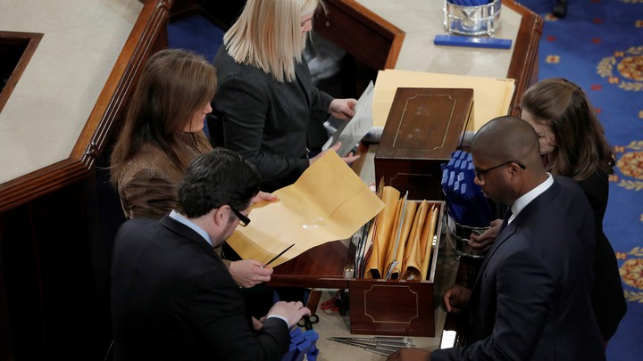 Congressional staffers count the ballots of the Electoral College