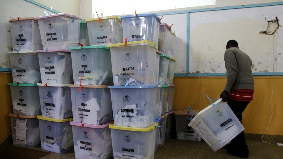 An election official from the Independent Electoral and Boundaries Commission arranges ballot boxes inside the Jamuhuri High School tallying center in Nairobi, Kenya, onAugust 9.