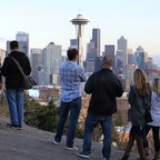 Onlookers survey the skyline of Seattle, Washington.