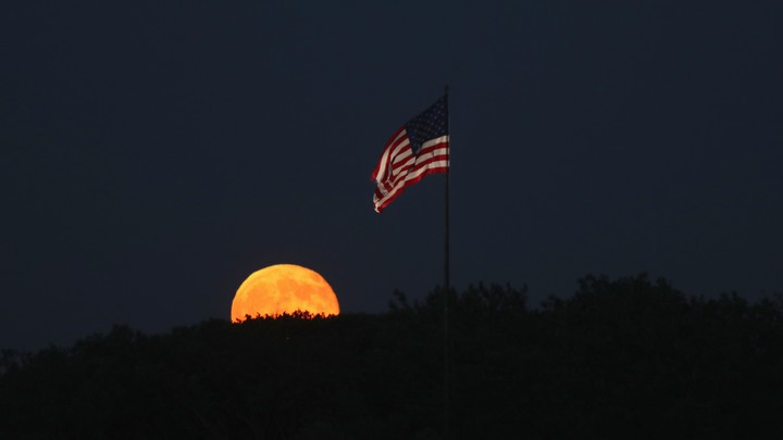 A full moon and the American flag.