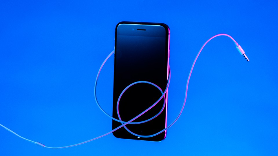 An iPhone with headphones