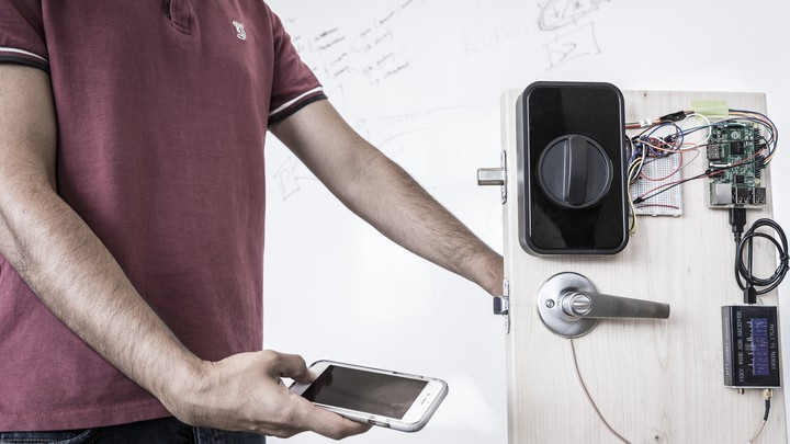 An engineer uses a smartphone's fingerprint reader to send a passcode through his body