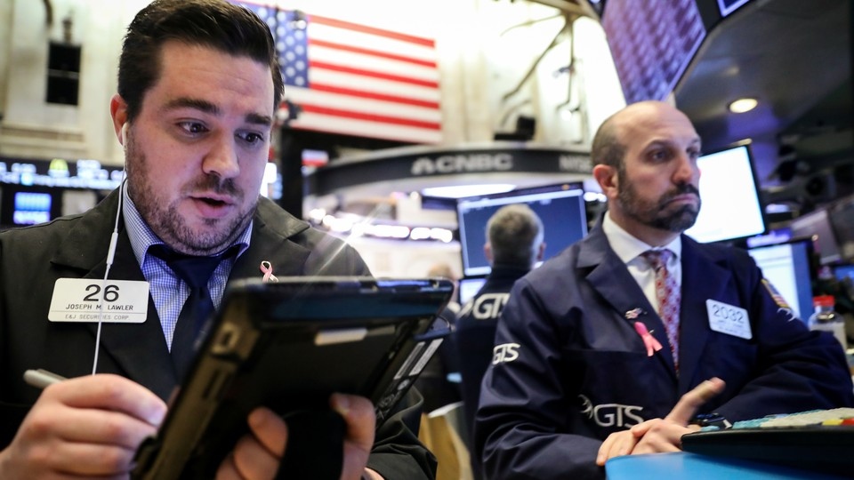 Traders work on the floor of the New York Stock Exchange on November 20, 2018.