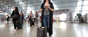 A woman waits for a flight at the airport in Chengdu.
