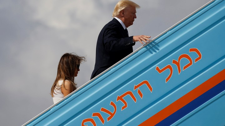 U.S. President Donald Trump and first lady Melania Trump board Air Force One to travel to Rome from Tel Aviv