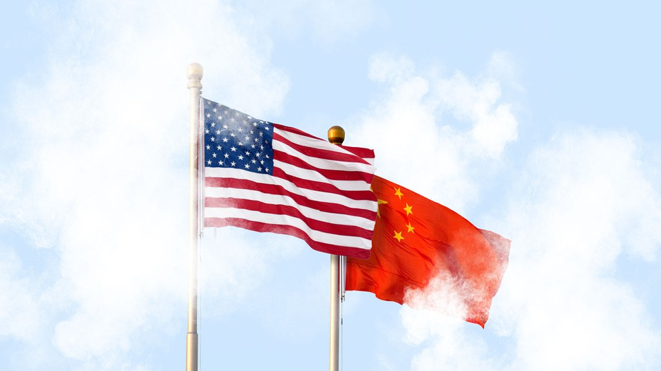 The U.S. and Chinese flags fly amid clouds.