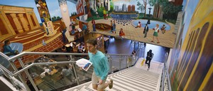 A student walks through Cabell Library at Virginia Commonwealth University in Richmond.