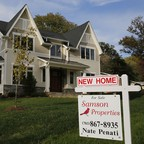 A large tan house for sale in Vienna, Virginia.