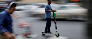 A man rides an electric scooter in Los Angeles.