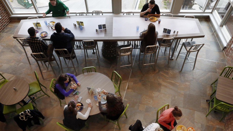 Students at the University of New Hampshire have lunch at a $17,000 custom-made, LED-light-equipped chef's table, which the university now acknowledges was an inappropriate purchase.