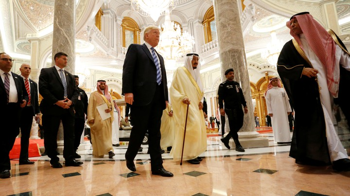 President Trump walks with Saudi Arabia's King Salman bin Abdulaziz Al Saud to deliver remarks to the Arab Islamic American Summit on May 21, 2017.