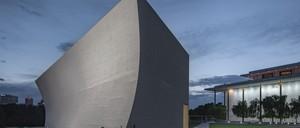 A small, sculptural concrete building standing beside Washington's Kennedy Center.