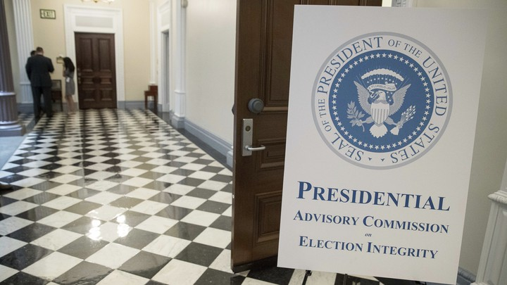 A sign advertising the voter-fraud commission outside of its first meeting