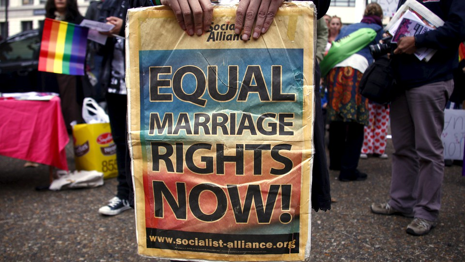 A placard supporting same-sex marriage is held at a rally in Sydney, Australia on May 31, 2015.