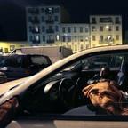 A man sleeps in his car.