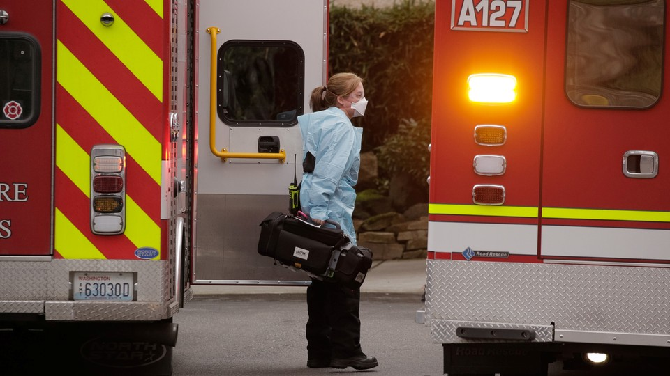 Ambulances in front of the Life Care Center of Kirkland.