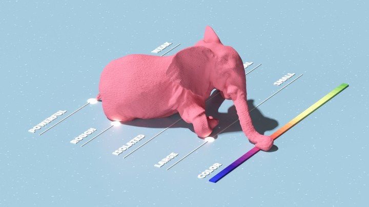 A model of a pink elephant with its trunk resting on a color spectrum