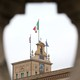 The Italian flag flutters at the Quirinal Palace during the two-day talks on government formation, after the March national elections, in Rome on April 4, 2018