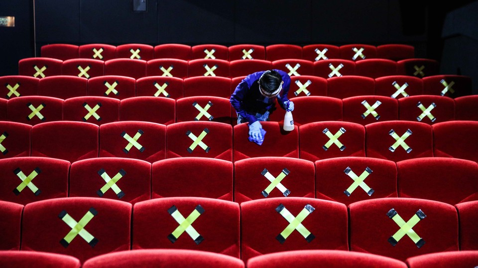 A movie theater being cleaned.
