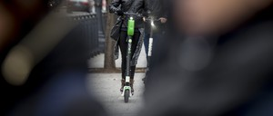 photo: a woman on an electric scooter