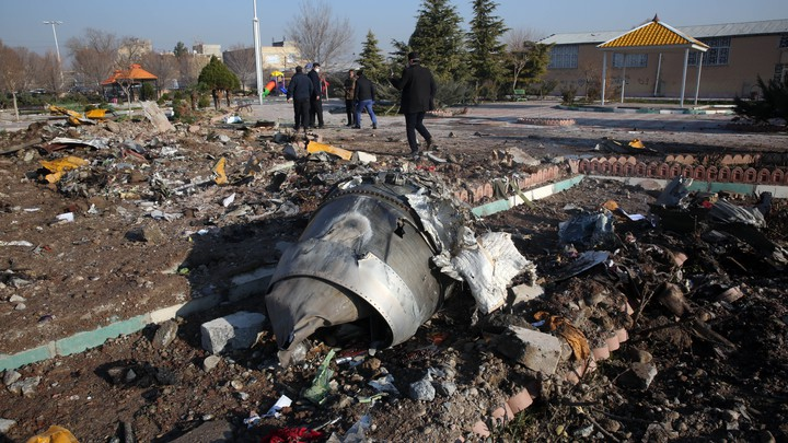 Rescue teams amid the debris of a Ukranian jet that crashed near Tehran's airport.