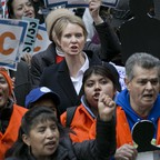 New York Democratic gubernatorial candidate Cynthia Nixon, center, joins with May Day protesters on Wall Street on Tuesday, May 1, 2018, in New York. Workers and activists marked May Day with rallies around the world.