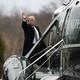 President Trump, waving, boards Marine One.