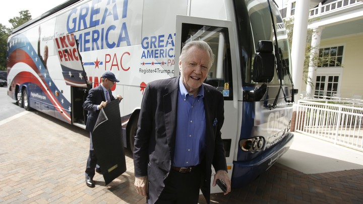 "The actor and vocal Trump-supporter Jon Voight leaving a ""Great America PAC"" bus."