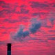 Steam rises from a smokestack at sunset in Lansing, Michigan, in January 2018.