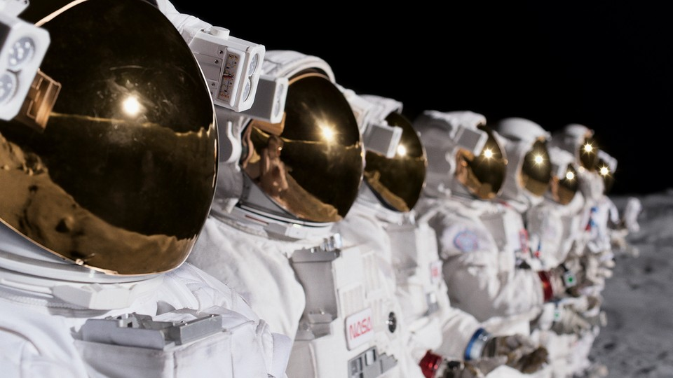 Astronauts standing in an orderly line