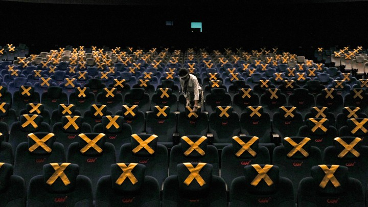 A mostly empty movie theater with one lone viewer in Jakarta, Indonesia