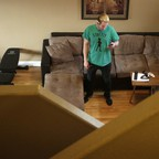 A man stands in an Airbnb rental.