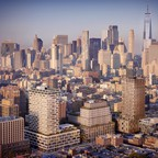 An architectural rendering of a large new development in Manhattan, set against the New York skyline.