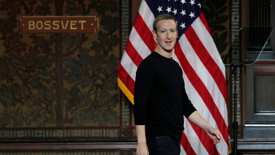 Mark Zuckerberg in front of an American flag at Georgetown University