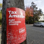 """A poster for Seattle city councilmember Kshama Sawant that reads """"Tax Amazon."""""""