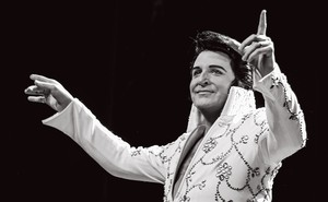 Dwight Icenhower dressed as Elvis on stage