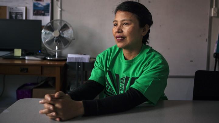 Edith Mendoza sitting smiling at a table