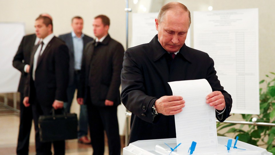 Russian President Vladimir Putin casts his ballot at a polling station during a parliamentary election in Moscow, Russia, September 18, 2016.