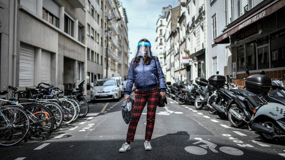 A woman wearing a face shield