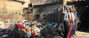 A boy scavenges through a pile of trash in a market in Beirut.
