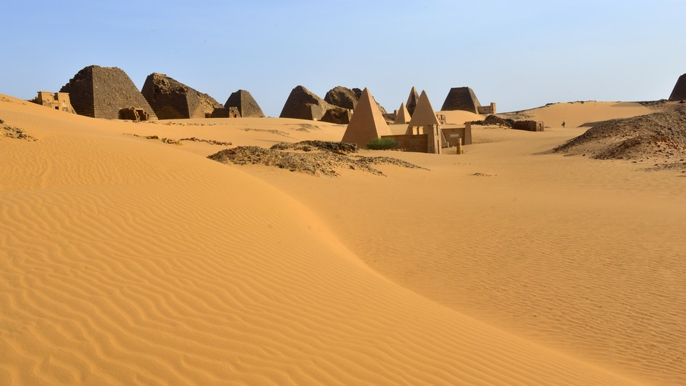 The ruins of several pyramids in the desert sands at Meroë, Sudan