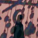 The silhouette of a woman against a backdrop of a children's mobile