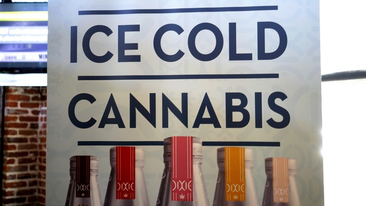 A banner hangs at the Dixie Elixirs company booth at the CannaSearch cannabis-industry job fair in downtown Denver on September 16, 2014.