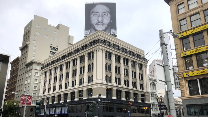 The former San Francisco quarterback Colin Kaepernick appears on a Nike advertisement pictured on top of a building in San Francisco on September 5, 2018.