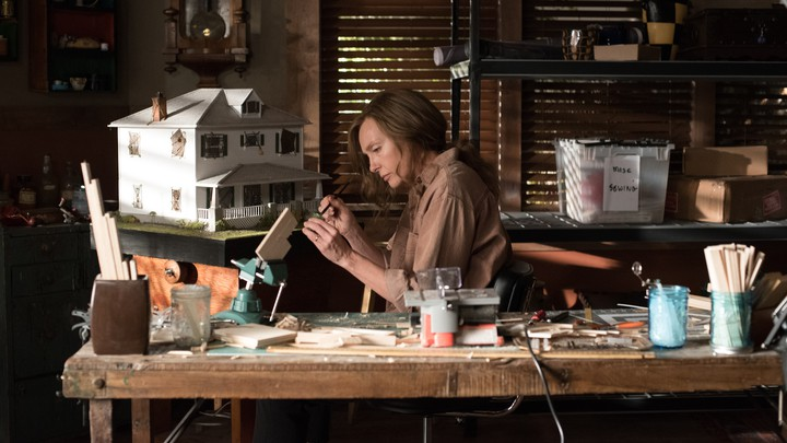 Annie Graham (Toni Collette) working in her home studio in the film 'Hereditary.'
